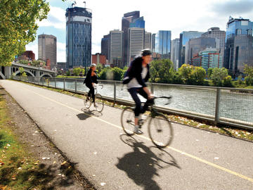 Cyclists riding on Calgary's urban pathway system.